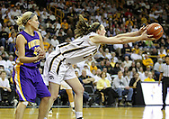 December 22 2010: Iowa center Morgan Johnson (12) grabs a ball as Northern Iowa guard/forward Erin Brocka (44) looks on during the second half of an NCAA college basketball game at Carver-Hawkeye Arena in Iowa City, Iowa on December 22, 2010. Iowa defeated Northern Iowa 75-64.