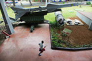 A Cuban boy on a school field trip to the Museo de la Revolución runs past wreckage from a U-2 spy plane and a replica of the missile that shot it down on October 27, 1962.