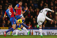Wayne Rooney of Manchester United (right) shoots during the Barclays Premier League match at Selhurst Park, London<br /> Picture by David Horn/Focus Images Ltd +44 7545 970036<br /> 22/02/2014