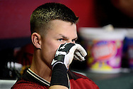PHOENIX, AZ - JULY 06:  Jake Lamb #22 of the Arizona Diamondbacks watches the game from the dugout during the first inning against the San Diego Padres at Chase Field on July 6, 2016 in Phoenix, Arizona.  (Photo by Jennifer Stewart/Getty Images)