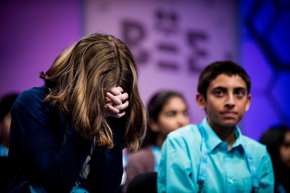 Erin Howard, 12, from Huntsville, Ala.,  reacts as a fellow speller misspells a word in the finals of the 2017 Scripps National Spelling Bee on Thursday, June 1, 2017 at the Gaylord National Resort and Convention Center at National Harbor in Oxon Hill, Md.      Photo by Pete Marovich/UPI