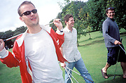 Three men laughing at a golf course, UK 2004