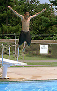 Neshaminy State Park, Bensalem, PA.-Greg Jones, 15, of Trenton, NJ. dives into the pool at Neshaminy State Park in Bensalem, Pa. on Thursday afternoon while trying to beat the heat. 2of3