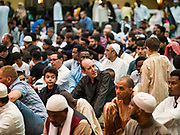 04 JUNE 2019 - DES MOINES, IOWA: Men pray during Eid al Fitr services in the Iowa Events Center in Des Moines Tuesday. About 3,000 people were expected to attend the annual community wide celebration of Eid al Fitr which marks the end of Ramadan, the Muslim month of fasting. According to the event organizers, there are about 15,000 Muslims in the Des Moines area.           PHOTO BY JACK KURTZ
