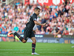 STOKE-ON-TRENT, ENGLAND - Sunday, August 9, 2015: Liverpool's Philippe Coutinho Correia celebrates scoring the first goal against Stoke City during the Premier League match at the Britannia Stadium. (Pic by David Rawcliffe/Propaganda)