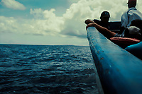 Boat, called a panga, makes way for Little Corn Island, Nicaragua, twenty miles to the north. Copyright 2017 Reid McNally.