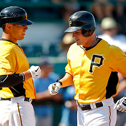 February 25, 2011; Bradenton, FL, USA; Pittsburgh Pirates infielder Brian Friday (77) celebrates with catcher Tony Sanchez (82) after hitting a homerun during a spring training exhibition game against the State College of Florida Manatees at McKechnie Field. The Pirates defeated the Manatees 21-1. Mandatory Credit: Derick E. Hingle