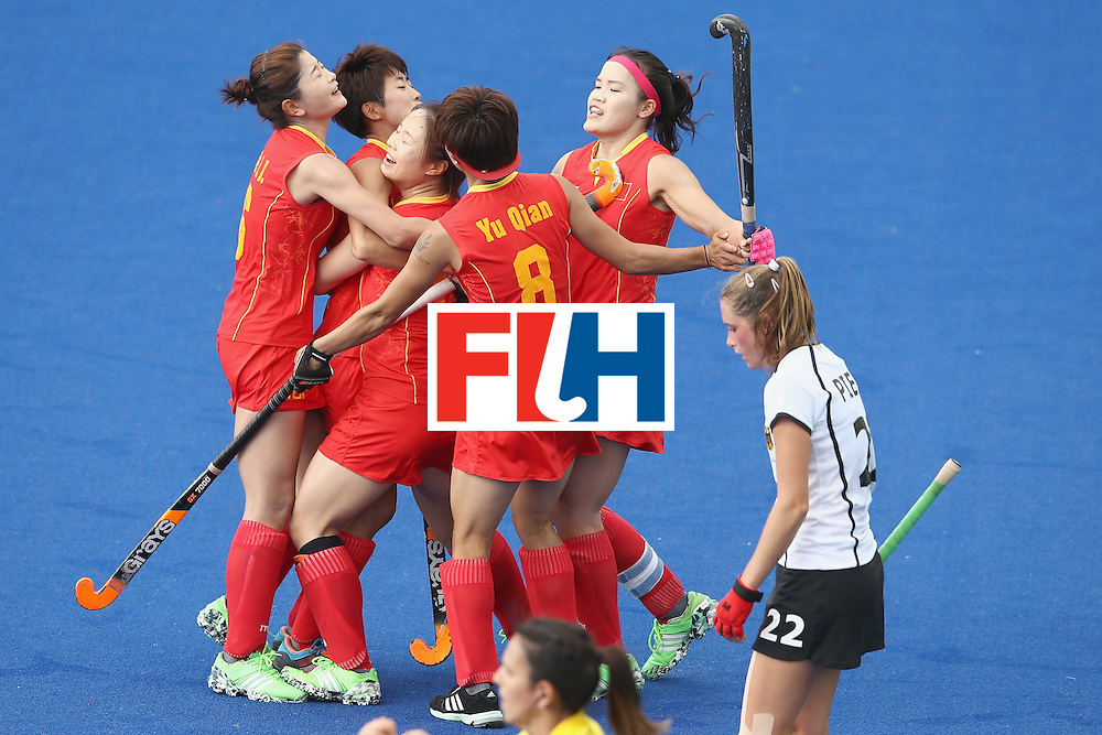 RIO DE JANEIRO, BRAZIL - AUGUST 07:  The China team celebrate with Yang Peng of China after she scored a goal during the women's pool A match between China and Germany on Day 2 of the Rio 2016 Olympic Games at the Olympic Hockey Centre on August 7, 2016 in Rio de Janeiro, Brazil.  (Photo by Mark Kolbe/Getty Images)