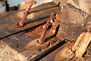 Aging, rotted beams and irons spikes on an old fishing pier, Gloucester, MA