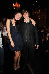AMBER ATHERTON and ALEX WATSON at the Tatler Little Black Book Party held at Tramp, 40 Jermyn Street, London on 3rd November 2010.