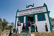 24 APRIL 2005 - SAN CRISTOBAL DE LAS CASAS, CHIAPAS, MEXICO:  Mayan Indians leave a small Catholic church after mass in San Cristobal de las Casas, Chiapas. The Catholic church in Chiapas is under increasing pressure and facing competition from evangelical Protestant churches in Mexico. PHOTO BY JACK KURTZ