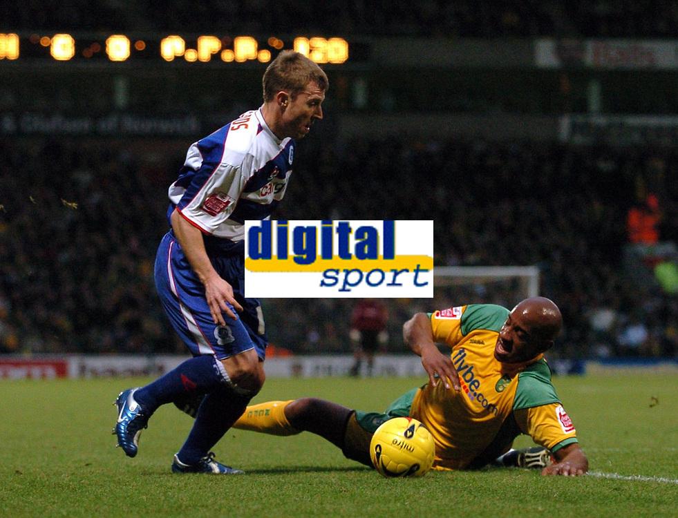 Photo: Ashley Pickering.<br />Norwich City v Queens Park Rangers. Coca Cola Championship. 30/12/2006.<br />QPR's Martin Rowlands (L) goes around Dion Dublin