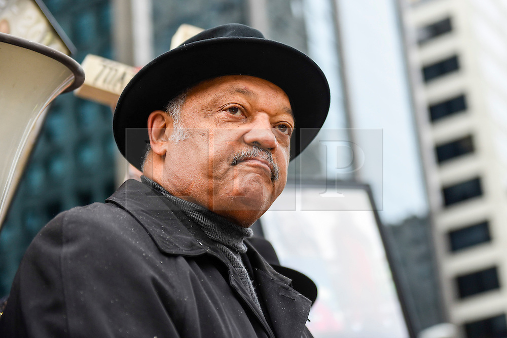 © Licensed to London News Pictures. 31/12/2016. Chicago, USA. Jesse Jackson (pictured) joins a Peace March, organised by Father Michael Pfleger, taking place down Chicago's Magnificent Mile, Michigan Avenue, to honour the survivors and victims of the city's escalating gun violence.  Marchers carry a 2-foot-tall white wooden cross, each bearing the name of a person killed by gun violence in 2016.  With over 4,300 shootings and more than 750 people killed in 2016, these are the highest totals for 20 years and more than any other large U.S. city in 2016, according to news reports. Photo credit : Stephen Chung/LNP