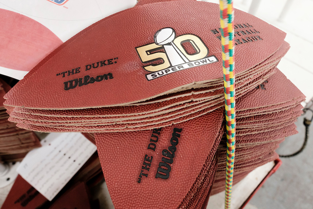 Panels of official balls for the NFL Super Bowl 50 football game are stacked up prior to being sewn at the Wilson Sporting Goods Co. in Ada, Ohio, Tuesday, Jan. 26, 2016. The Denver Broncos will play the Carolina Panthers in the Super Bowl on Feb. 7 in Santa Clara, CA. (AP Photo/Rick Osentoski)