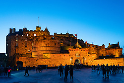 Edinburgh Castle floodlit at dusk in winter, Scotland, UK