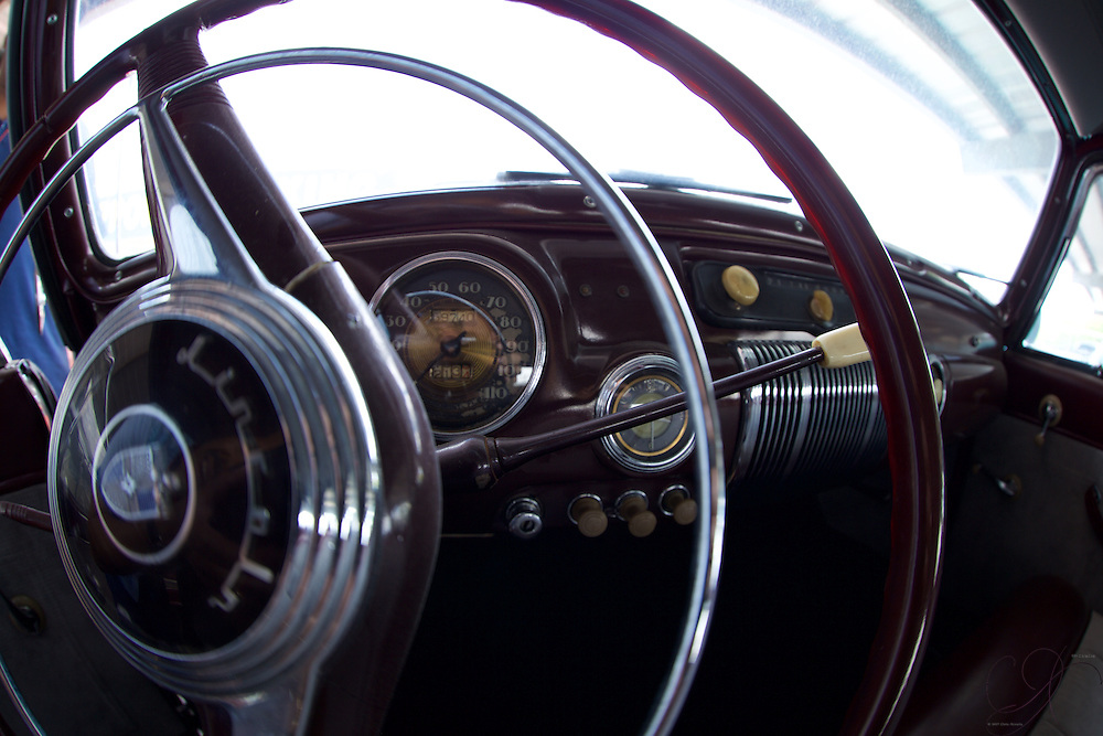 Inside of a mint condition 1941 Lincoln Continental. The dash offers a glimpse into a timeless design philosophy at Lincoln - that clock can be found in late model Towncars today as a homage to this time period.