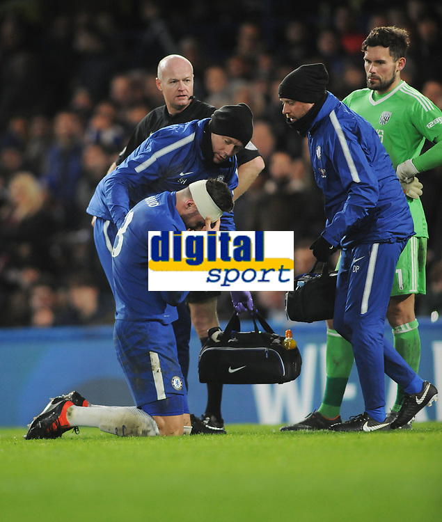 Football - 2017 / 2018 Premier League - Chelsea vs. West Bromwich Albion<br /> <br /> Olivier Giroud of Chelsea has his head bandaged after a clash of heads at Stamford Bridge.<br /> <br /> COLORSPORT/ANDREW COWIE
