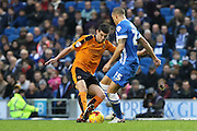 Wolverhampton Wanderers midfielder Conor Coady (16) beats Brighton striker, Bobby Zamora (25) in a tackle  during the Sky Bet Championship match between Brighton and Hove Albion and Wolverhampton Wanderers at the American Express Community Stadium, Brighton and Hove, England on 1 January 2016. Photo by Phil Duncan.