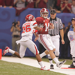 2 January 2009: Alabama quarterback John Parker Wilson (14) is pushed out of bounds by Utah cornerback Bryce Bennion (26) during the 75th annual All State Sugar Bowl  between the Utah Utes and the Alabama Crimson Tide at the Louisiana Superdome in New Orleans, LA.