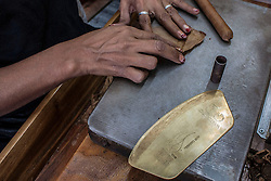 A person works next to a commemorative peg of the 50th anniversary of Cohiba brand during the 18th International Habano Cigar Festival, at the Cohiba tobacco factory, in El Laguito, Havana, Cuba, on March 3, 2016. The 18th International Habano Cigar Festival is held from Feb. 29 to March 4. EXPA Pictures © 2016, PhotoCredit: EXPA/ Photoshot/ Joaquin Hernandez<br />