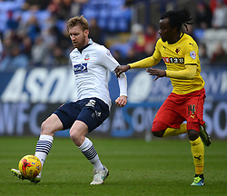 Bolton Wanderers' Tim Ream competes with Watford's Juan Carlos Paredes - Photo mandatory by-line: Richard Martin-Roberts/JMP - Mobile: 07966 386802 - 14/02/2015 - SPORT - Football - Bolton - Macron Stadium - Bolton Wanderers v Watford - Sky Bet Championship