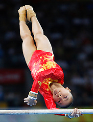 China's He Kexin competes on the uneven bars of artistic gymnastics apparatus finals during the Olympic games in Beijing, China, 18 August 2008. He won the gold for the event.