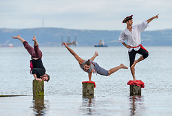 Acrobats Thomas Gorham, Rowan Thomas  and Cal Harris practice their skills in the sea at Portobello in preparation for their show at this years Fringe, 'Arr we there yet?'<br /> <br /> © Dave Johnston/ EEm