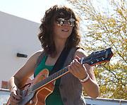 Laura Kepner-Adney plays guitar for the Silver Thread Trio during their concert at Fiesta en el Barrio Viejo 2010, Tucson, Arizona.