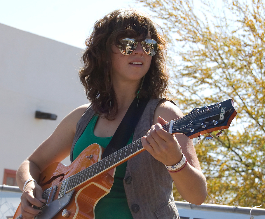 Laura Kepner-Adney plays guitar for the Silver Thread Trio during their concert at Fiesta en el Barrio Viejo 2010, Tucson, Arizona. The all-day concert is now known as Fiesta en el Barrio. Event photography by Martha Retallick.