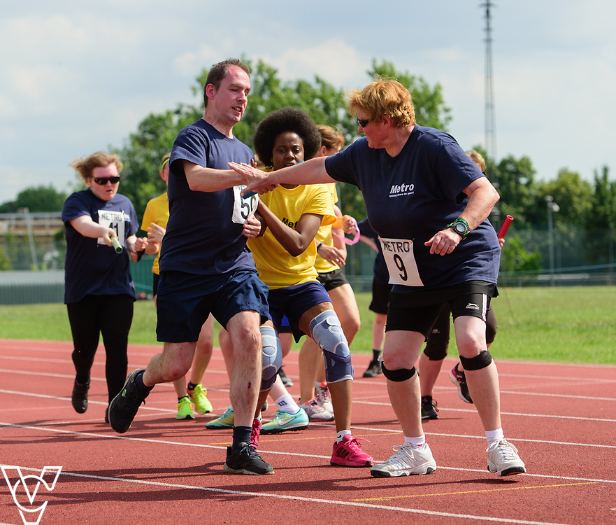 Metro Blind Sport's 2017 Athletics Open held at Mile End Stadium.  4x100m relay.  Vanja Sudar with guide runner, left, hands over the button to Angela McCool<br /> <br /> Picture: Chris Vaughan Photography for Metro Blind Sport<br /> Date: June 17, 2017