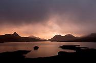 Dawn breaking over Loch Bad a Ghaill, Assynt, Scotland.