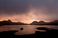 Dawn breaking over Loch Bad a Ghaill, Assynt, Scotland.