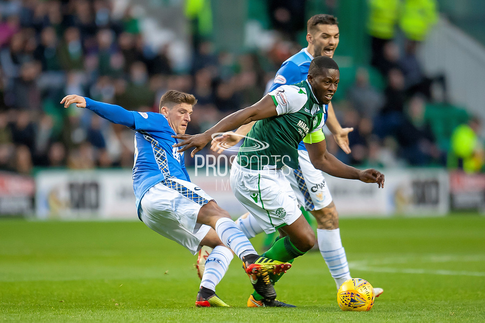 Matthew Kennedy (#33) of St Johnstone FC trips Marvin Bartley (#6) of Hibernian FC during the Ladbrokes Scottish Premiership match between Hibernian and St Johnstone at Easter Road, Edinburgh, Scotland on 3 November 2018.