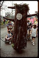 Papier-mache tree marches amid kids and adults in Earth Day parade at Forest Park, St. Louis Missouri