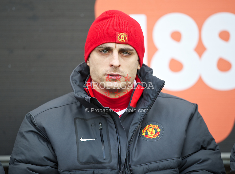 WIGAN, ENGLAND - Saturday, February 26, 2011: Manchester United's substitute Dimitar Berbatov on the bench before the Premiership match against Wigan Athletic at the DW Stadium. (Photo by David Rawcliffe/Propaganda)