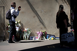 © Licensed to London News Pictures. 20/06/2017. London, UK. Floral tributes are left near the entrance to the Finsbury muslim welfare centre where worshippers were targeted in an attack yesterday. One person has been killed and 10 people are injured. Darren Osborne, 47, from Cardiff, continues to be held on suspicion of attempted murder and alleged terror offences.  Photo credit: Peter Macdiarmid/LNP