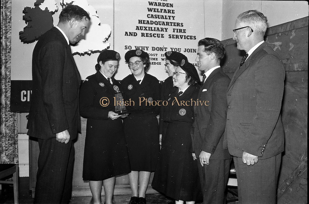 31/03/1963<br /> 03/31/1963<br /> 31 March 1963<br /> Civil Defence Competitions at Jervis Street Hospital, Dublin sponsored by W.D. & H.O. Wills Ltd., for the Gold Flake Trophy. Picture shows (l-r): Mr. D.R. Mott, General Manager Wills, and winning Rathmines team, Miss Frances Todd; Miss Carmel Doyle; Miss Eithne McManus and Mrs F. Brierton with their instructor Mr. Steve Donoghue and Mr. Michael O'Brien, Dublin Civil Defence Officer.