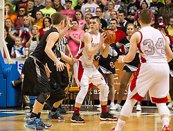 Poca guard Luke Frampton (14) backs down a defender against Westside during a semi-final game at the Charleston Civic Center.