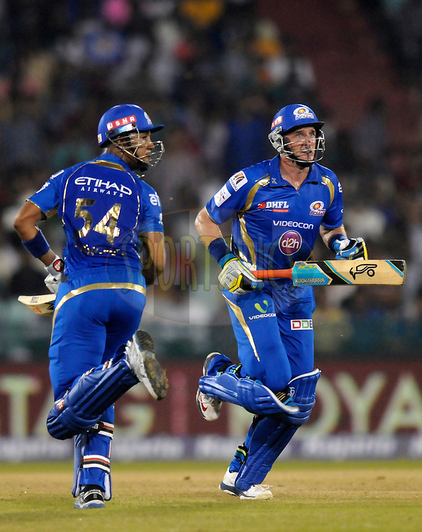 Michael Hussey of Mumbai Indians and Lendl simmons of Mumbai Indians run between the wickets during the qualifier 4 match of the Oppo Champions League Twenty20 between the Mumbai Indians and the Southern Express held at the Chhattisgarh International Cricket Stadium, Raipur, India on the 14th September 2014<br /> <br /> Photo by:  Pal Pillai / Sportzpics/ CLT20<br /> <br /> <br /> Image use is subject to the terms and conditions as laid out by the BCCI/ CLT20.  The terms and conditions can be downloaded here:<br /> <br /> http://sportzpics.photoshelter.com/gallery/CLT20-Image-Terms-and-Conditions-2014/G0000IfNJn535VPU/C0000QhhKadWcjYs