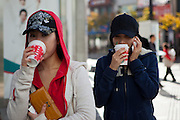 "Two Korean women with a ""take out"" coffee in the city of Daegu. Daegu, also known as Taegu and officially the Daegu Metropolitan City, is the third largest metropolitan area in South Korea, and by city limits, the fourth largest city with over 2.5 million people. The IAAF World Championships in Athletics will take place in Daegu from the 27th of August till the 4th of September 2011."