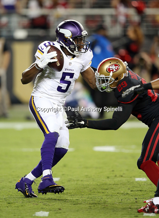 Minnesota Vikings quarterback Teddy Bridgewater (5) gets sacked by San Francisco 49ers rookie strong safety Jaquiski Tartt (29) and forcing a punt during the 2015 NFL week 1 regular season football game against the San Francisco 49ers on Monday, Sept. 14, 2015 in Santa Clara, Calif. The 49ers won the game 20-3. (©Paul Anthony Spinelli)