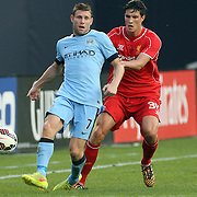 Martin Kelly, (right), Liverpool, is challenges James Milner, Manchester City, during the Manchester City Vs Liverpool FC Guinness International Champions Cup match at Yankee Stadium, The Bronx, New York, USA. 30th July 2014. Photo Tim Clayton
