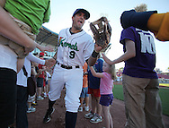 Kernels third baseman Jeremy Cruz (9) takes the field before their game at Perfect Game Field at Veterans Memorial Stadium in Cedar Rapids on Wednesday, June 9, 2010. The Kernels defeated the Whitecaps 5-2.