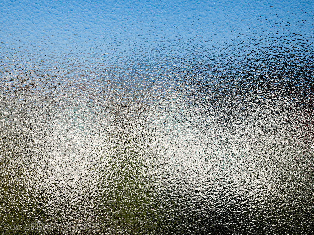 Early morning condensation on a pane of glass turns the world into a nice even texture.