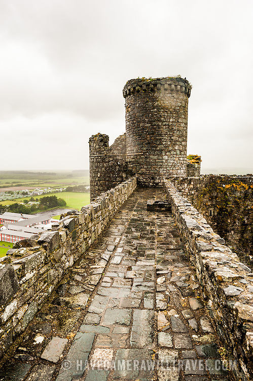 Tower and ramparts at Harlech Castle in Harlech, Gwynedd, on the northwest coast of Wales next to the Irish Sea. The castle was built by Edward I in the closing decades of the 13th century as one of several castles designed to consolidate his conquest of Wales.