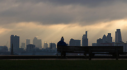 Primrose Hill, London, February 15th 2015. A man takes in the view of London's skyline on a chilly early morning on Primrose Hill, overlooking London&rsquo;s skyline.<br /> ///FOR LICENCING CONTACT: paul@pauldaveycreative.co.uk TEL:+44 (0) 7966 016 296 or +44 (0) 20 8969 6875. &copy;2015 Paul R Davey. All rights reserved.