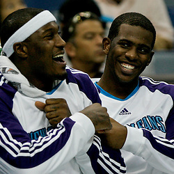Oct 10, 2009; New Orleans, LA, USA; New Orleans Hornets forward James Posey (left) and guard Chris Paul (right) share a laugh on the bench during a preseason game against the Oklahoma City Thunder at the New Orleans Arena. The Hornets defeated the Thunder 88-79. Mandatory Credit: Derick E. Hingle-US PRESSWIRE