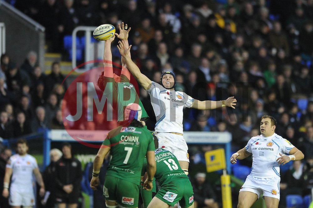 London Irish blindside flanker, Tom Guest challenges for the ball with Exeter Chiefs' Lock, Dean Mumm - Photo mandatory by-line: Dougie Allward/JMP - Mobile: 07966 386802 - 11/01/2015 - SPORT - RUGBY - Reading - Madejski Stadium - London Irish v Exeter Chiefs - Aviva Premiership