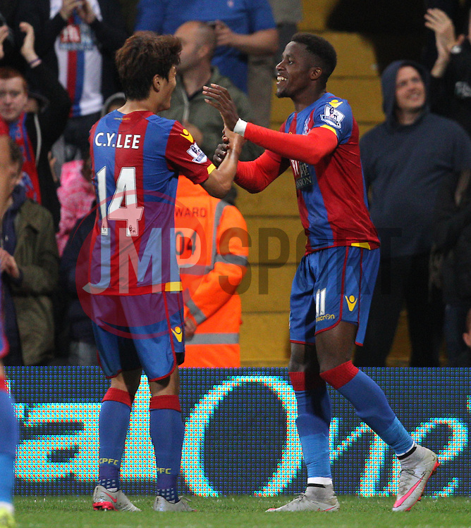 Wilfried Zaha ( R ) of Crystal Palace celebrates with Lee Chung-Yong after he scores to make it 4-1 - Mandatory byline: Paul Terry/JMP - 07966386802 - 25/08/2015 - FOOTBALL - Selhurst Park -London,England - Crystal Palace v Shrewsbury town - Capital One Cup - Second Round