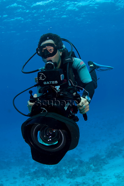 Underwater videographer, profile, front view, Vaavu Atoll, The Maldives